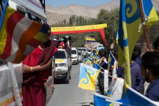 Well-wishers bearing the auspicious 16th Karmapa Dream Flag. Photo / Magda Jungowska