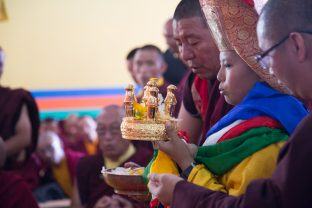 Chime Rinpoche offering the mandala to Thaye Dorje, His Holiness the 17th Gyalwa Karmapa. Photo / Magda Jungowska