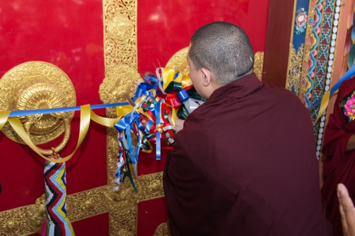 Thaye Dorje, His Holiness the 17th Gyalwa Karmapa, cutting the ribbon to inaugurate the Karma Dupgyud Choeling Monastery. Photo / Magda Jungowska