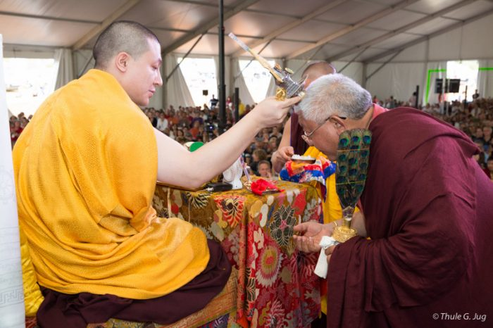 Thaye Dorje, His Holiness the 17th Gyalwa Karmapa, blesses Lama Jigme Rinpoche at Dhagpo Kagyu Ling. Photo / Thule Jug
