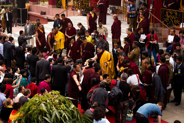 For almost four hours, His Holiness moves through the rows of the gathered devotees to transmit the final blessing with the ritual implements. Photo/Norbu Zangpo
