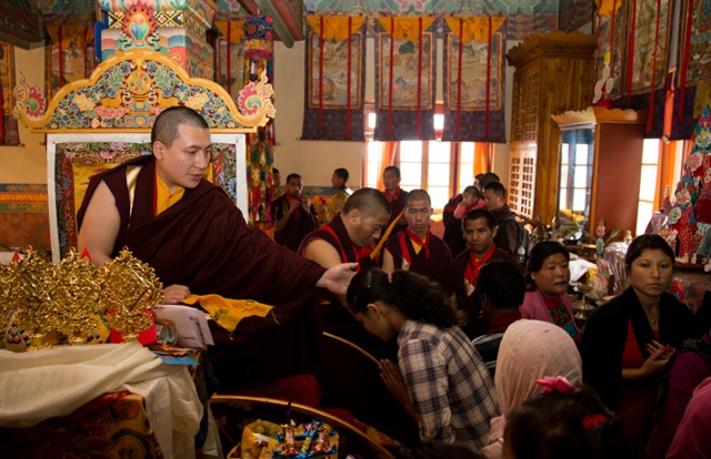 Gyalwa Karmapa presents the symbolic offerings of ku sung thuk (enlightened body, speech and mind) to Kunsig Shamar Rinpoche during the early-morning puja on Losar day, followed by the recitation of long-life prayers and offering of katas