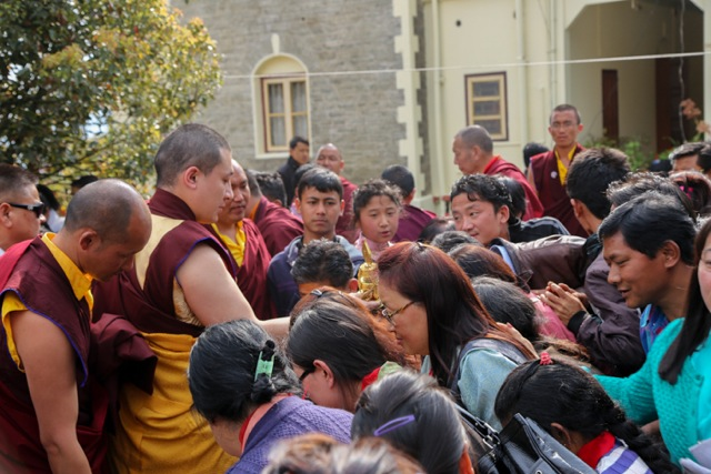 Devotees crowding around His Holiness to receive the blessing with the ritual implements after the empowerment