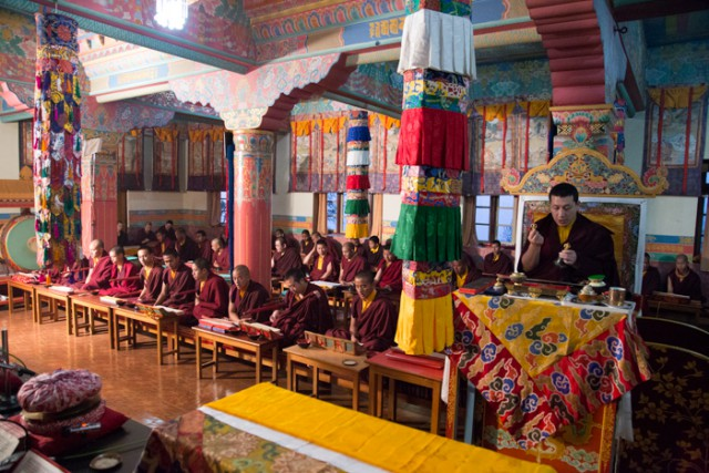 His Holiness the 17th Gyalwa Karmapa together with a gathering of Rinpoches, monks and nuns, performing the Grand Mahakala Puja