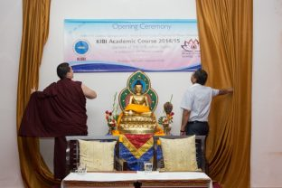 Thaye Dorje, His Holiness the 17th Gyalwa Karmapa, and the Chairman of Mewar University symbolically open the new academic semester by lighting a lamp and unveiling the poster. Photo/Norbu Zangpo