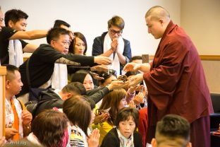 Thaye Dorje, His Holiness the 17th Gyalwa Karmapa, blesses the meditation beads of visiting students
