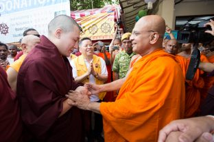 Thaye Dorje, His Holiness the 17th Gyalwa Karmapa greeting the Chief Venerable of the Buddhist Maha Vihara, Ven. Ming Ji, Chairman of MBA Selangor State, in Malaysia 2016. Photo / Magda Jungowska