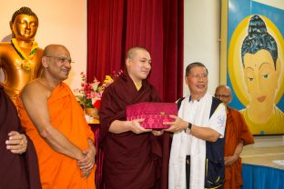 Thaye Dorje, His Holiness the 17th Gyalwa Karmapa, receiving a gift from the Maha Buddhist Vihara. Photo / Magda Jungowska