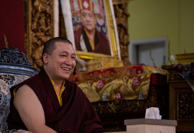 Thaye Dorje, His Holiness the 17th Gyalwa Karmapa, with a photo of his late teacher His Holiness Kunzig Shamar Rinpoche, during the Karmapa Public Course at KIBI. Photo / Norbu Zangpo