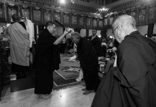Thaye Dorje, His Holiness the 17th Gyalwa Karmapa blesses Lama Jigme Rinpoche during the Chenresig empowerment at the KIBI Public Course