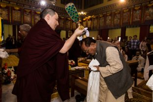 Thaye Dorje, His Holiness the 17th Gyalwa Karmapa blesses Professor Sempa Dorje during the Chenresig empowerment at the KIBI Public Course