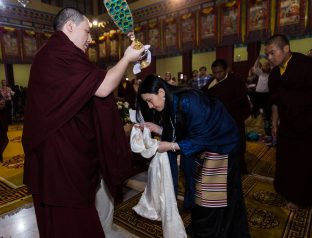 Thaye Dorje, His Holiness the 17th Gyalwa Karmapa blesses his wife Sangyumla during the Chenresig empowerment at the KIBI Public Course