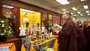 Thaye Dorje, His Holiness the 17th Gyalwa Karmapa, in front of the altar at the New Horizon Buddhist Association Bodhi Path Buddhist Centre in Hong Kong