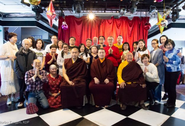 Thaye Dorje, His Holiness the 17th Gyalwa Karmapa, His Eminence 4th Jamgon Kongtrul Rinpoche and His Eminence Beru Khyentse Rinpoche, together with students at a traditional fish release ceremony in Hong Kong