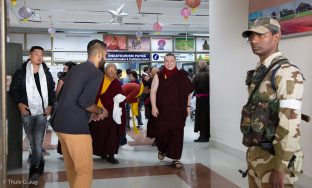 Thaye Dorje, His Holiness the 17th Gyalwa Karmapa, arrives at Gaya airport with Jigme Rinpoche, Karmapa's General Secretary, on the way to Bodh Gaya for the 2018 Kagyu Monlam