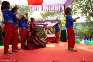 Pupils perform for Thaye Dorje, His Holiness the 17th Gyalwa Karmapa, at the Bodhi Tree School in Bodh Gaya