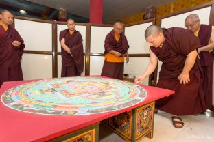 Thaye Dorje, His Holiness the 17th Gyalwa Karmapa, puts the finishing touches on the sand mandala of Chakrasamvara