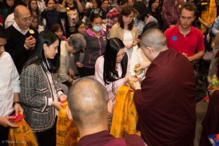 Sangyumla Rinchen Yangzom receives a blessing from Thaye Dorje, His Holiness the 17th Gyalwa Karmapa, at the Chenresig empowerment in Hong Kong