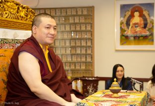 Thaye Dorje, His Holiness the 17th Gyalwa Karmapa, visits the New Horizon Buddhist Association Bodhi Path Buddhist Centre in Hong Kong. His wife, Sangyumla Rinchen Yangzom, looks on in the background.