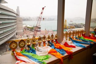 Audiences with Thaye Dorje, His Holiness the 17th Gyalwa Karmapa, with Hong Kong harbour in the background