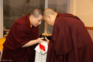 Jangon Kongtrul Rinpoche receives a bowl from Thaye Dorje, His Holiness the 17th Gyalwa Karmapa