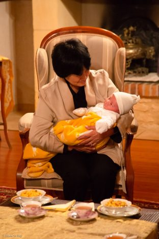 Mayum Mrs Kunzang, Sangyumla Rinchen Yangzom's mother, cradles Thugsey (her grandson)