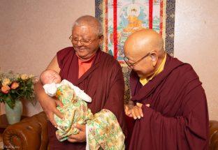 Jigme Rinpoche, Karmapa's General Secretary and Solponla Tsultrim Namgyal, Karmapa's Senior Attendant, smile at Thugsey (Karmapa's son)