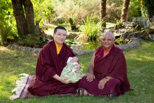 Thaye Dorje, His Holiness the 17th Gyalwa Karmapa, rests with Jigme Rinpoche, Karmapa's General Secretary, while Thugsey (his son) also takes a rest