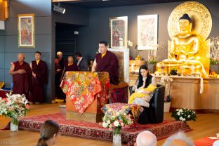 Students pray with Thaye Dorje, His Holiness the 17th Gyalwa Karmapa, Sangyumla Rinchen Yangzom, and Thugsey (their son) at Dhagpo Kagyu Ling