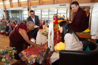 Jigme Rinpoche, Karmapa's General Secretary, makes an offering of ku sung thuk to Thugsey (Karmapa's son) during a special reception at Dhagpo Kagyu Ling
