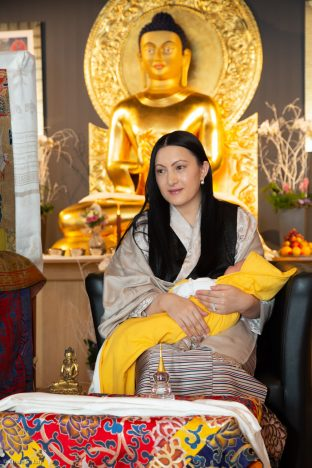 Sangyumla Rinchen Yangzom cradles Thugsey (her son) during a special reception at Dhagpo Kagyu Ling