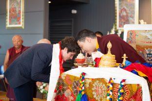 Thaye Dorje, His Holiness the 17th Gyalwa Karmapa, blesses Gendun Rinchen, Yangsi of Gendun Rinpoche, during a special reception at Dhagpo Kagyu Ling
