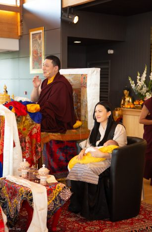 Thaye Dorje, His Holiness the 17th Gyalwa Karmapa, with his wife Sangyumla Rinchen Yangzom and Thugsey (their son) by his side during a special reception at Dhagpo Kagyu Ling