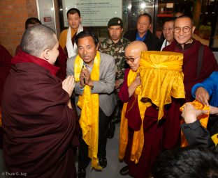 Karmapa is welcomed by Mr Rabindra Prasad Adhikari, Minister of Culture, Tourism and Civil Aviation in Nepal, Venerable Sang Sang Rinpoche, Venerable Lodro Rinpoche, and other lamas and local devotees.