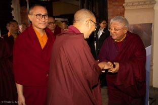Jigme Rinpoche, Karmapa's General Secretary, is welcomed by Shangpa Rinpoche. Lodro Rinpoche in the background.