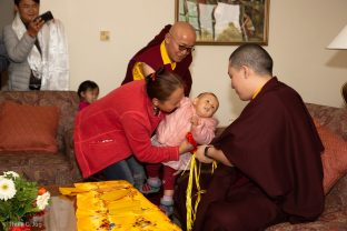 A young girl gazes up at Karmapa