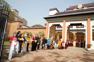 Students and monks keenly await Karmapa's arrival at KIBI