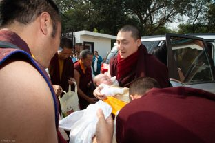 Karmapa and his four month old son Thugsey arrive at KIBI