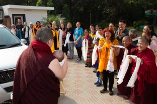 The crowd delights at the arrival of Karmapa and baby Thugsey