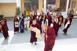 Monks greet Karmapa and baby Thugsey