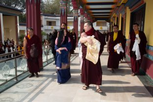 Karmapa, Sangyumla Rinchen Yangzom and their son Thugsey arrive at KIBI.