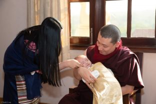 Karmapa and Sangyumla Rinchen Yangzom share a special moment with their son Thugsey
