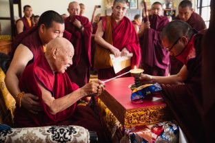 His Eminence Luding Khenchen Rinpoche, the 75th head of the Ngor tradition of the Sakya school of Tibetan Buddhism, presides over the hair-cutting ceremony of Thugsey, in the presence of Karmapa, Sangyumla and many monks from various Karma Kagyu monasteries