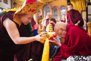 With humble appreciation, Karmapa offered His Eminence Luding Khenchen Rinpoche a mandala, a symbolic offering of body, speech and mind, together with other auspicious offerings