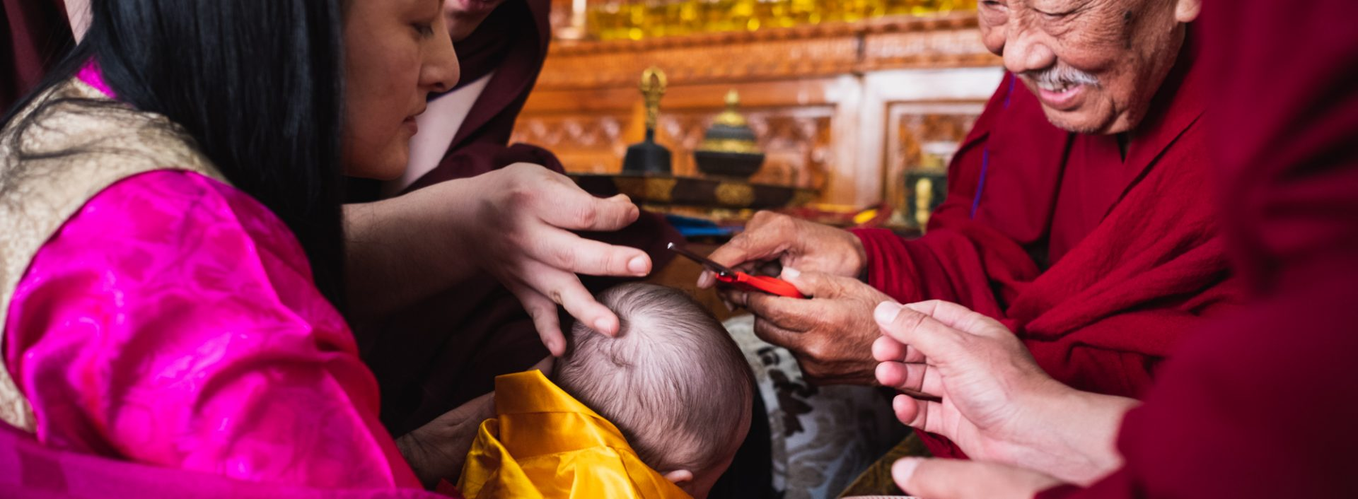 The moment when His Eminence Luding Khenchen Rinpoche, the 75th head of the Ngor tradition of the Sakya school of Tibetan Buddhism, cuts the hair of Thugsey, symbolizing his taking refuge in the Three Jewels: the Buddha, the dharma and the sangha