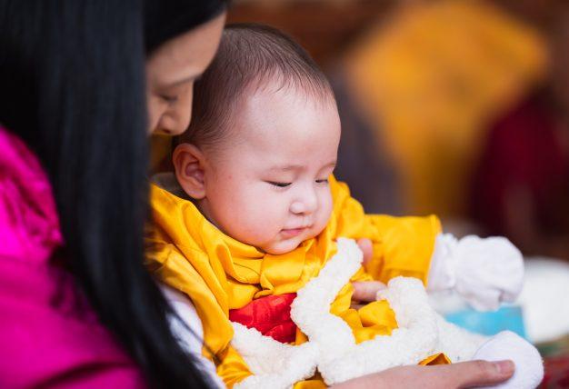A mother's love: Sangyumla cradles baby Thugsey. Photo/Tokpa Korlo
