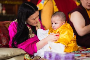 A tender moment as Sangyumla holds little Thugsey during the hair-cutting ceremony