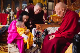 His Eminence Luding Khenchen Rinpoche and Thugsey look into each other's eyes during the historic hair-cutting ceremony