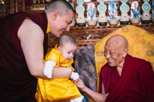 His Eminence Luding Khenchen Rinpoche, the 75th head of the Ngor tradition of the Sakya school of Tibetan Buddhism, smiles warmly at little Thugsey, Karmapa's son
