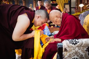 A moment of deep respect as Thaye Dorje, His Holiness the 17th Gyalwa Karmapa, offers His Eminence Luding Khenchen Rinpoche a mandala and a symbolic offering of body, speech and mind